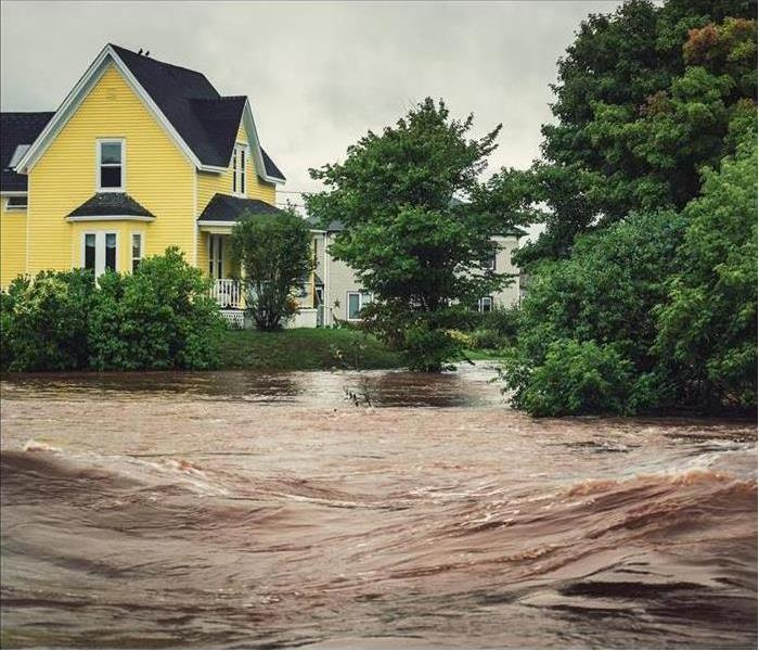 A house surrounded by floodwater