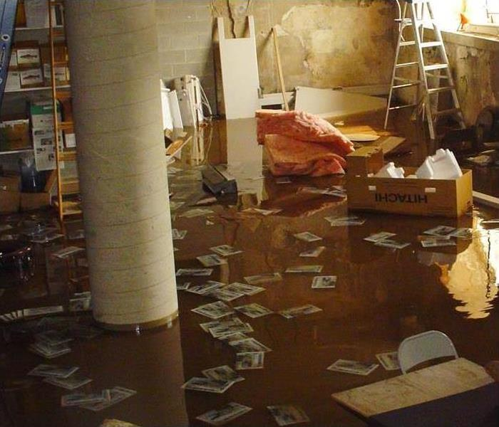 A flooded basement with items floating in water