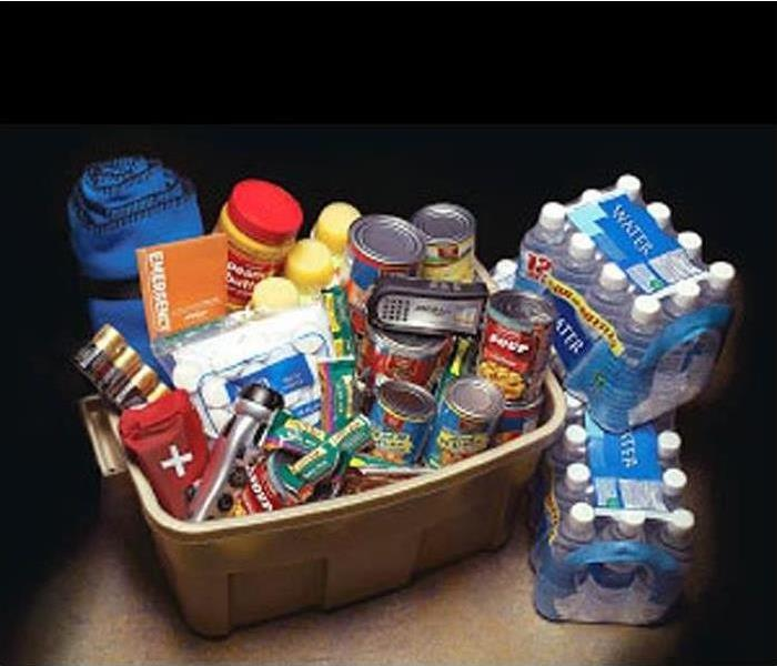 Plastic bin packed with food, water and other supplies to survive a storm.